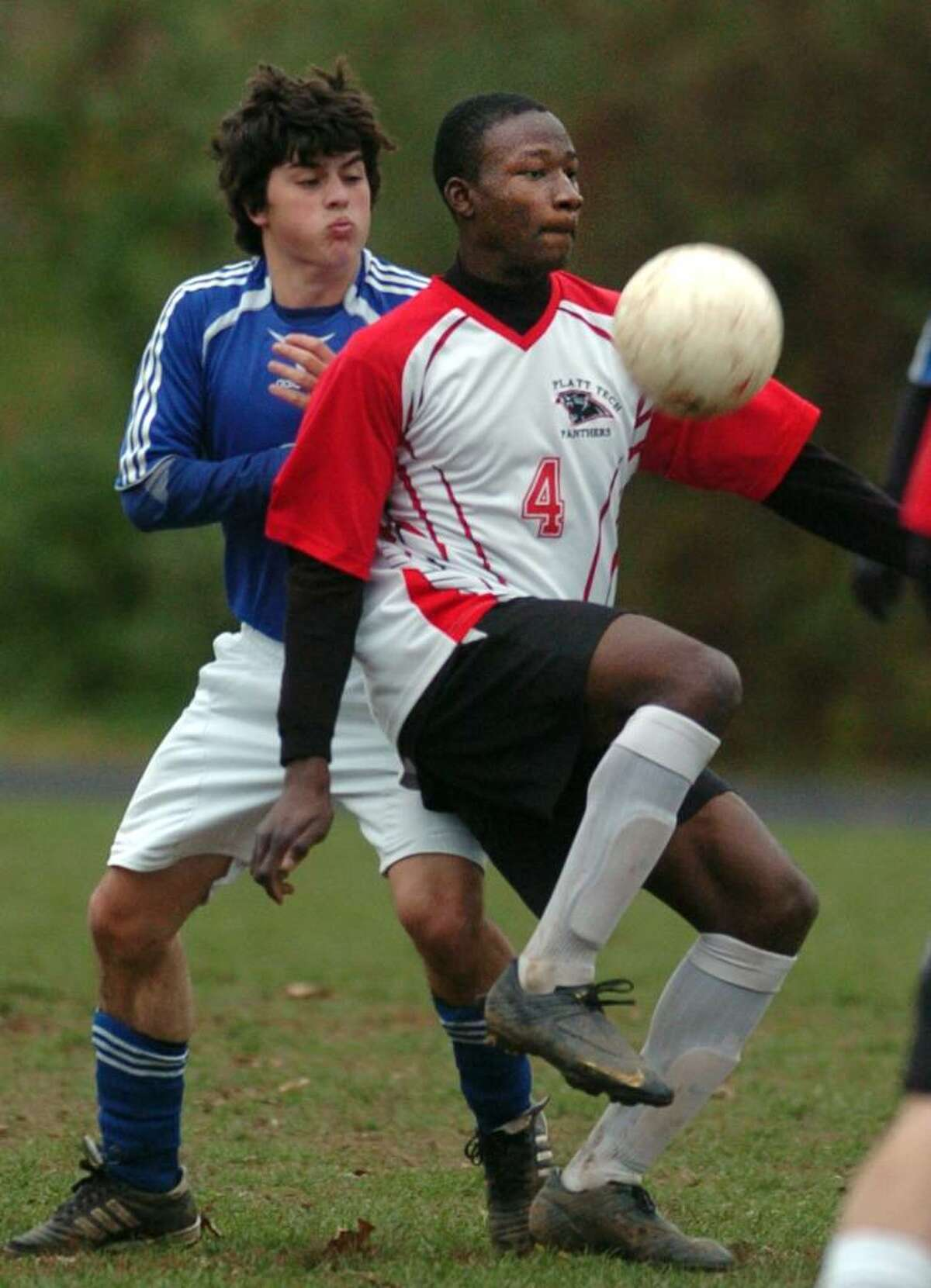 Platt Tech's Bruno Chima controls the ball as Fairfield Ludlowe's Luke Carter knocks into him during the first half of Thursday's Class L second round game in Milford.