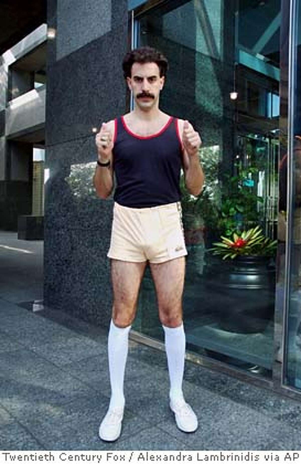 """*** FILE *** In this undated photo provided by Twentieth Century Fox, Kazakhstani TV talking head Borat (Sacha Baron Cohen) is dispatched to the United States to report on the greatest country in the world in """"Borat."""" Sacha Baron Cohen, whose fictional Kazakh reporter Borat has sparked controversy, says he could never put himself and others in embarrassing situations if he weren't in character.""""I think I'd find it hard to,"""" Cohen says in an interview with Rolling Stone magazine. """"I think you can hide behind the characters and do things that you yourself find difficult."""" (AP Photo/Twentieth Century Fox/Alexandra Lambrinidis )"""