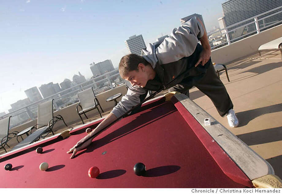 Biedrins on his balcony in oakland, playing pool. Feature story on Warriors center Andris Biedrins and his emergence as a top player, photographed at the warriors headquarters in Oakland and at the home of Biedrins, in Oakland..(CHRSTINA KOCI HERNANDEZ/CHRONICLE) Photo: CHRISTINA KOCI HERNANEZ/CHRONICL