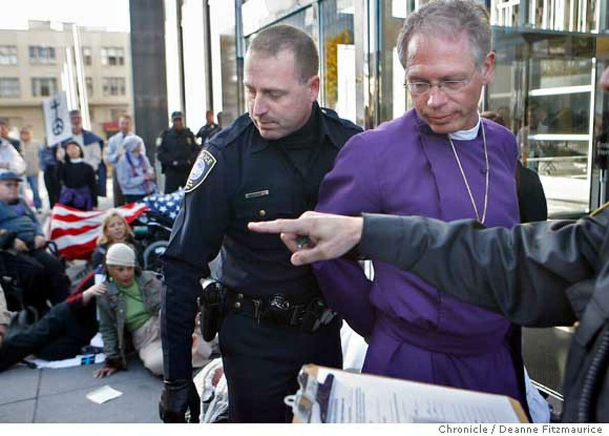 civilbishop08_0133_df.jpg Rev. Marc Handley Andrus , Episcopal Bishop of California was arrested today as he blocked the entrance to the Federal Building with others in an act of civil disobedience against the war in Iraq. Photographed in San Francisco on 12/7/06. (Deanne Fitzmaurice/ The Chronicle) Ran on: 12-08-2006 Other protesters, including Matt Cantor (front center) chant, sing and block the doorway at the federal building but were not arrested. Ran on: 12-08-2006 Other protesters, including Matt Cantor (front center) chant, sing and block the doorway at the federal building but were not arrested. Ran on: 12-08-2006 Other protesters, including Matt Cantor (front center) chant, sing and block the doorway at the federal building during the protest. Those shown here were not among the 12 arrested. Ran on: 12-08-2006 Ran on: 12-08-2006 Top: Protesters, including Matt Cantor (front center) chant, sing and block the doorway at the federal building during the demonstration. Those shown were not among the 12 arrested. Left: Rev. Marc Handley Andrus, Episcopal Bishop of California, was arrested as he blocked the entrance to the federal building after moving to the doorway because he had been passed over by police earlier.
