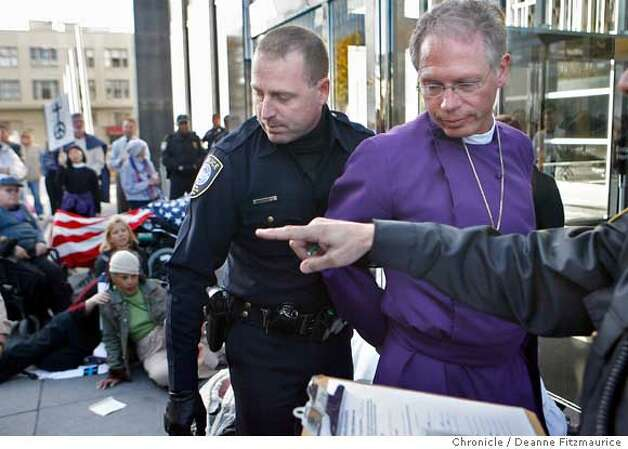 civilbishop08_0133_df.jpg  Rev. Marc Handley Andrus , Episcopal Bishop of California was arrested today as he blocked the entrance to the Federal Building with others in an act of civil disobedience against the war in Iraq. Photographed in San Francisco on 12/7/06. (Deanne Fitzmaurice/ The Chronicle) Ran on: 12-08-2006  Other protesters, including Matt Cantor (front center) chant, sing and block the doorway at the federal building but were not arrested.  Ran on: 12-08-2006  Other protesters, including Matt Cantor (front center) chant, sing and block the doorway at the federal building but were not arrested.  Ran on: 12-08-2006  Other protesters, including Matt Cantor (front center) chant, sing and block the doorway at the federal building during the protest. Those shown here were not among the 12 arrested.  Ran on: 12-08-2006 Ran on: 12-08-2006  Top: Protesters, including Matt Cantor (front center) chant, sing and block the doorway at the federal building during the demonstration. Those shown were not among the 12 arrested. Left: Rev. Marc Handley Andrus, Episcopal Bishop of California, was arrested as he blocked the entrance to the federal building after moving to the doorway because he had been passed over by police earlier. Photo: Deanne Fitzmaurice