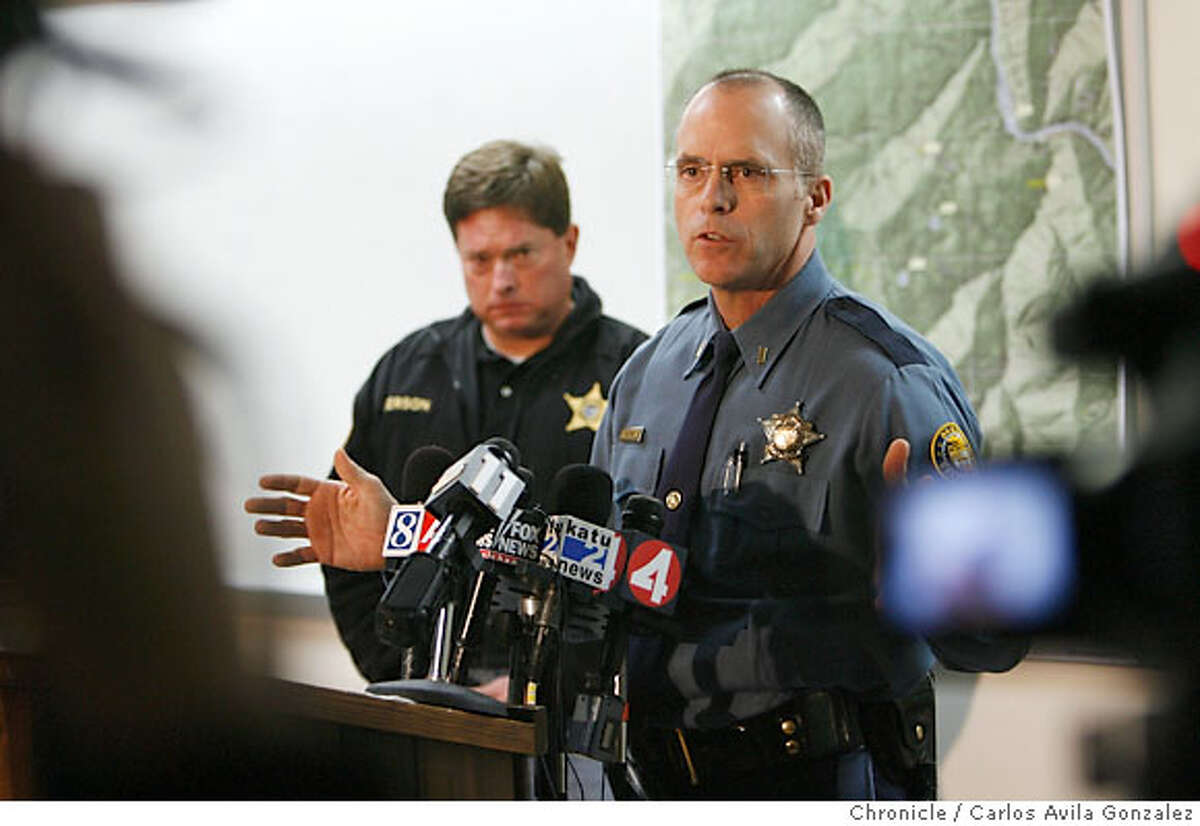 Lt. Gregg Hastings of the Oregon State Police addresses the media at a press conference in Center Point, Or., detailing the autopsy results on James Kim. Behind Hastings is Josephine County Undersheriff Brian Anderson. Local and state authorities announced on Thursday, December 7, 2006, the results of the autopsy on James Kim after his body was discovered by search and rescue personnel on Wednesday. The San Francisco man whose family was rescued Monday after they were lost in the mountains outside of Merlin, Or., set out on foot to try to find help, but died of hypothermia and exposure as he attempted to bring assistance to his wife and two daughers. Photo by Carlos Avila Gonzalez/The San Francisco Chronicle Photo taken on 12/7/06, in Central Point, Or, USA. **All names cq (source)