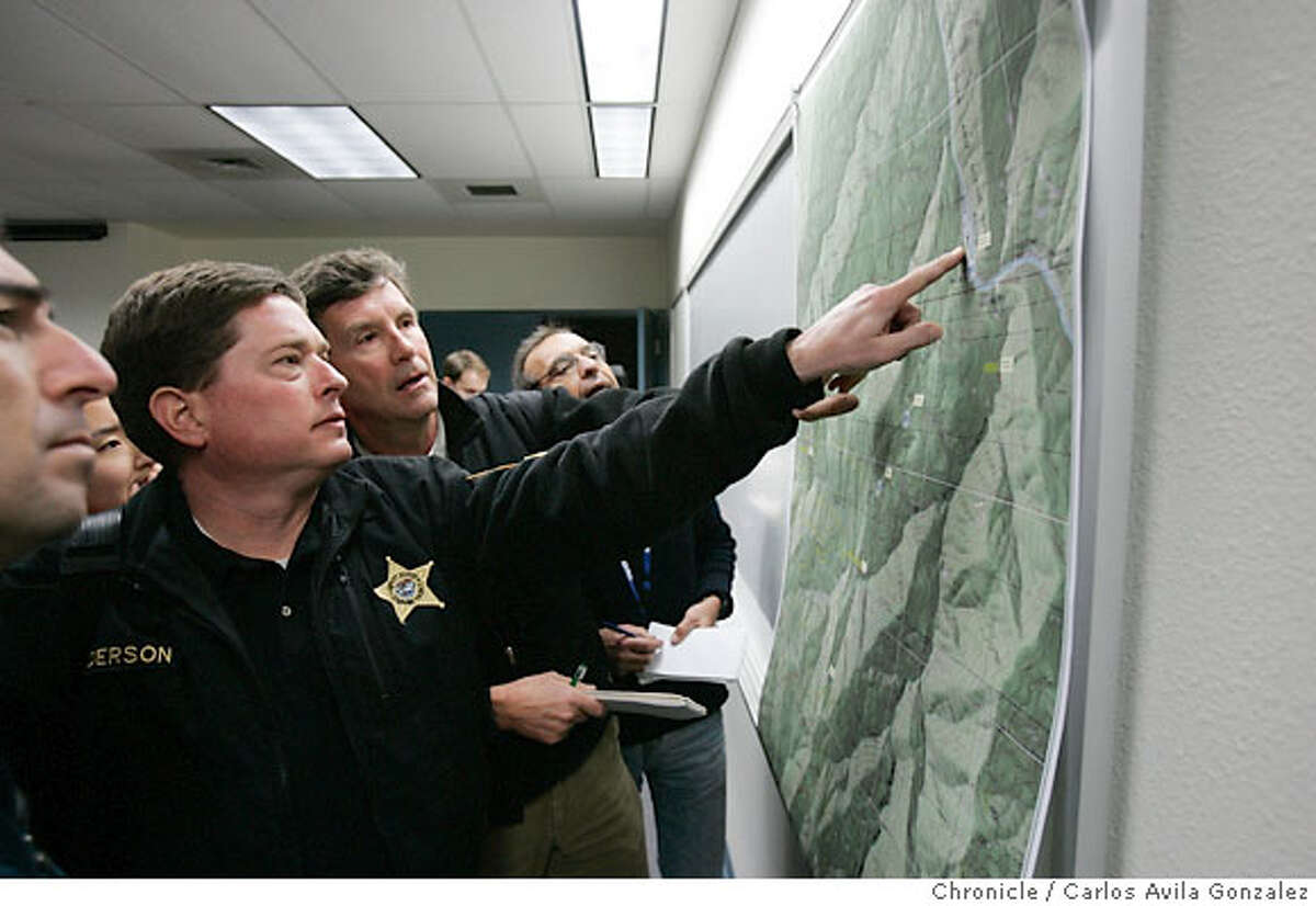 Josephine County Undersheriff Brian Anderson points out search details following a press conference in Center Point, Or., on Thursday, December 7, 2006. Local and state authorities announced on Thursday, December 7, 2006, the results of the autopsy on James Kim after his body was discovered by search and rescue personnel on Wednesday. The San Francisco man whose family was rescued Monday after they were lost in the mountains outside of Merlin, Or., set out on foot to try to find help, but died of hypothermia and exposure as he attempted to bring assistance to his wife and two daughers. Photo by Carlos Avila Gonzalez/The San Francisco Chronicle Photo taken on 12/7/06, in Central Point, Or, USA. **All names cq (source)