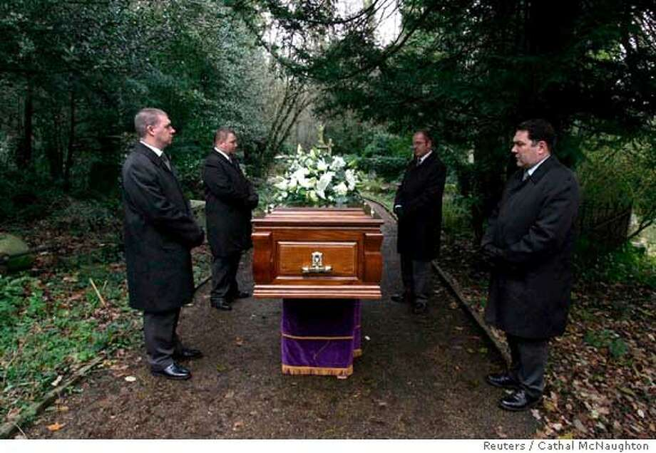 Coffin bearers stand with the coffin of former Russian spy Alexander Litvinenko during his funeral at Highgate Cemetery in London December 7, 2006. Russian prosecutors launched their own murder investigation on Thursday into the death in London from radiation poisoning of Russian ex-spy Litvinenko, in parallel to a British probe already under way. REUTERS/Cathal McNaughton/Pool (BRITAIN)  Ran on: 12-08-2006  Pallbearers stand with the coffin of former Russian spy Alexander Litvinenko during his funeral.  Ran on: 12-08-2006  Pallbearers stand with the coffin of former Russian spy Alexander Litvinenko during his funeral. Photo: POOL