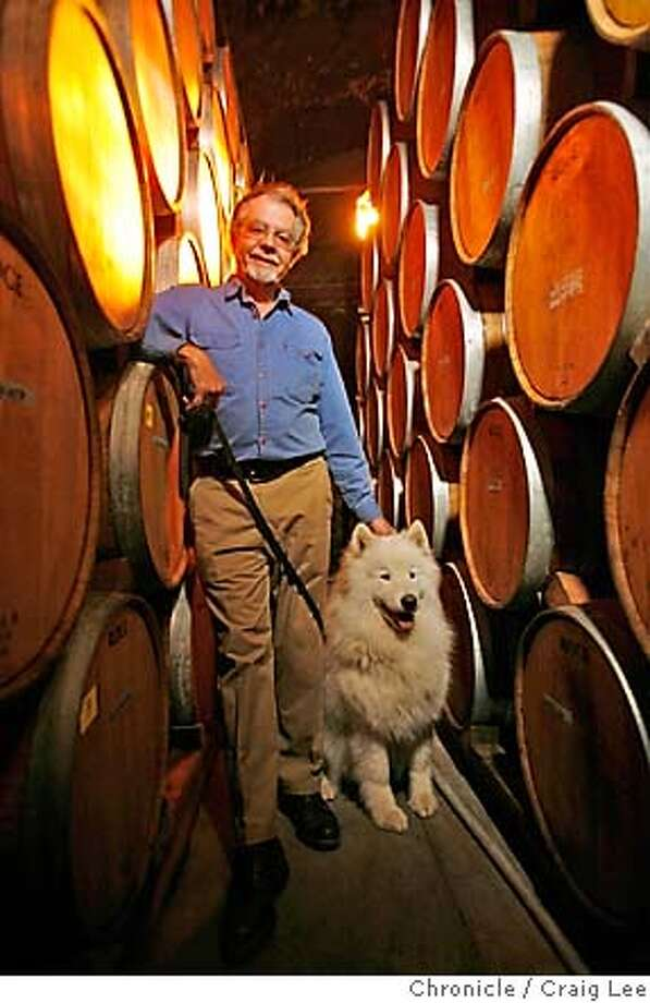 WINEMAKER08_237_cl.JPG  Paul Draper, winemaker for Ridge Winery. His dog, Bodhi, is with him. Photo in the cellar.  Event on 12/5/06 in Cupertino. MANDATORY CREDIT FOR PHOTOG AND SF CHRONICLE/ -MAGS OUT Photo: Photo By Craig Lee