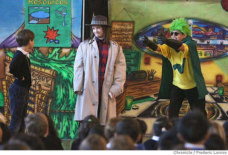 Actors Nicole Weber (center) and Luis Cortes, with Minneapolis, Minn. based National Theatre for Children, interact with Alec Moysov (age 8) and other school children at St. Gabriel's school during a performance concerning renewable energy. The theater company is a for-profit organization that aims to market to children. 12/5/06  {Photographed by Frederic Larson} Ran on: 12-08-2006  National Theatre for Children actors Nicole Weber (center) and Luis Cortes interact with Alec Moysov (left), 8, at St. Gabriel's Parish Elementary School during a program on renewable energy. Photo: Frederic Larson