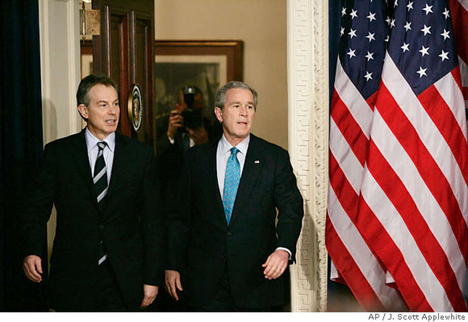 President Bush, right, and British Prime Minister Tony Blair arrive for their joint news conference following their meeting, Thursday, Dec. 7, 2006 in the Eisenhower Executive Office Building in Washington. (AP Photo/J. Scott Applewhite) Photo: J. SCOTT APPLEWHITE
