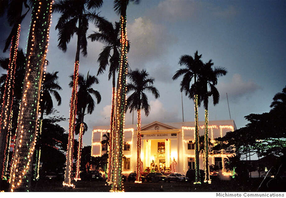 Kauai's historic county building in Lihue is lit for Christmas in the annual Festival of Lights.  Photo credit: Michimoto Communications Photo: Michimoto Communications