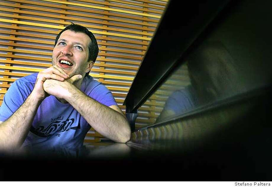 ADES.6.jpg  British composer/pianist/conductor Thomas Ad�s seats at a piano for a portrait after a rehearsal at Disney Hall in Los Angeles, on Wed. November 29, 2006 in Los Angeles.  By STEFANO PALTERA/SPECIAL TO THE CHRONICLE  Stefano Paltera Photo: Stefano Paltera