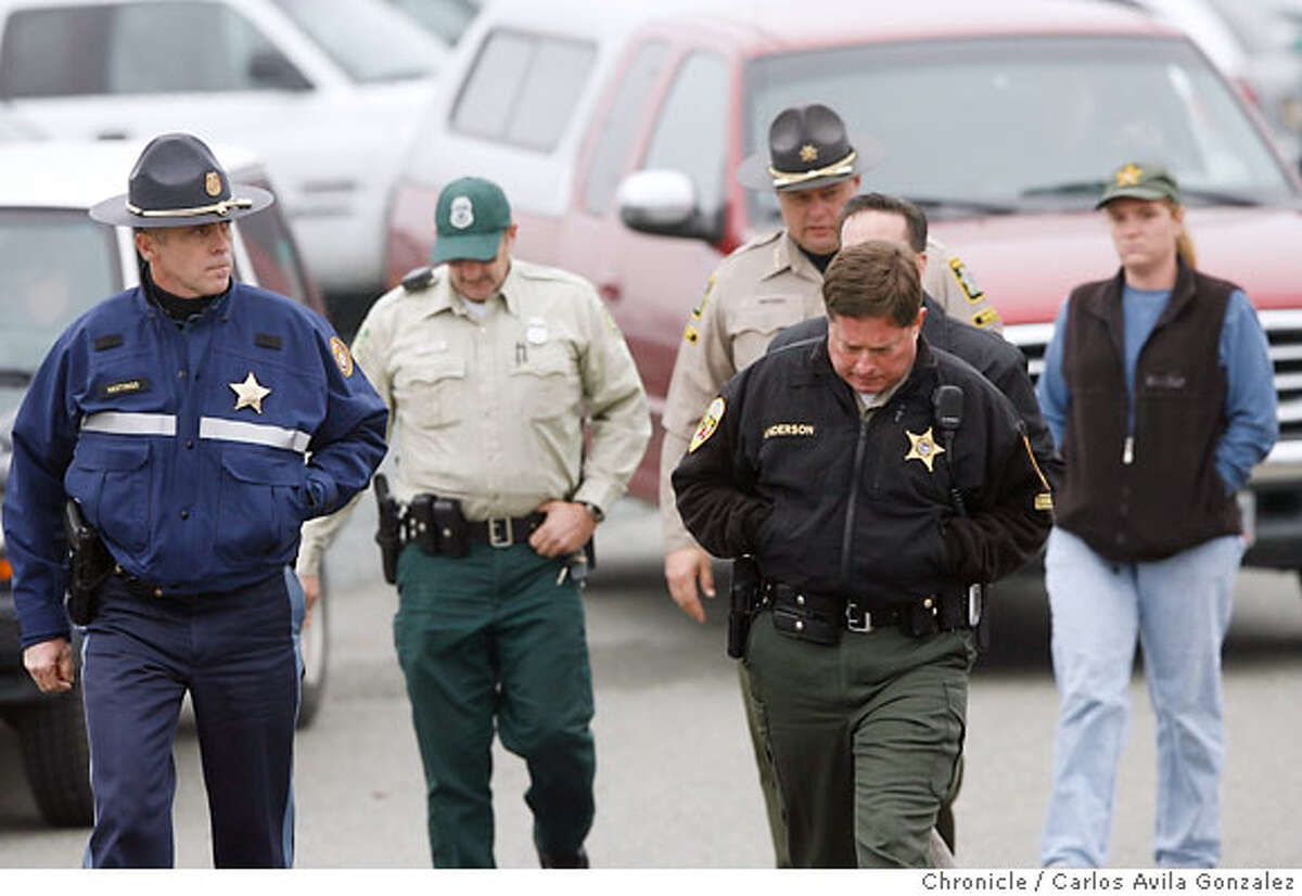 Appearing upset as they make their way to a press conference, local and state authorities announced that their search for James Kim had concluded on Wednesday, December 6, 2006, after his body was discovered by search and rescue personnel. The San Francisco man whose family was rescued Monday after they were lost in the mountains outside of Merlin, Or., set out on foot to try to find help, but died as he attempted to bring assistance to his wife and two daughers. Photo by Carlos Avila Gonzalez/The San Francisco Chronicle Photo taken on 12/6/06, in Merlin, Or, USA. **All names cq (source)
