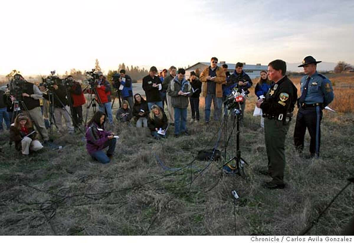 Oregon State Police Lt. Greg Hastings, right, and Josephine County Undersheriff, Brian Anderson, at microphone, brief the media after the discovery of a pair of pants and an unidentified item believed to belong to james Kim were found in the search area. Local and state authorities and search and rescue personnel continued their search for James Kim, the San Francisco man whose family was rescued after they were lost in the mountains outside of Merlin, Or., on Tuesday, December 5, 2006. Kim set out on foot to try to find help, but has not been located although his family was rescued Monday at the family car. Photo by Carlos Avila Gonzalez/The San Francisco Chronicle Photo taken on 12/5/06, in Merlin, Or, USA. **All names cq (source)