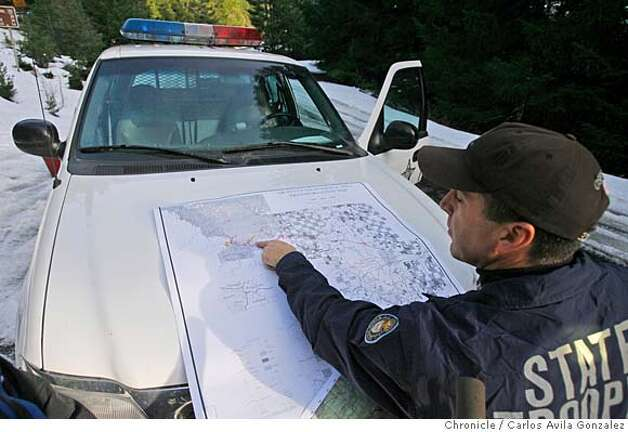 Sgt. Jeff Proulx of the Oregon State Police looks over a map where the search for James Kim is concentrating along Bear Camp Road where Kim was trapped due to bad weather over a week ago. Local and state authorities and search and rescue personnel continued their search for James Kim, the San Francisco man whose family was rescued after they were lost in the mountains outside of Merlin, Or., on Tuesday, December 5, 2006. Kim set out on foot to try to find help, but has not been located although his family was rescued Monday at the family car.  Photo by Carlos Avila Gonzalez/The San Francisco Chronicle  Photo taken on 12/5/06, in Merlin, Or, USA.  **All names cq (source) Photo: Carlos Avila Gonzalez