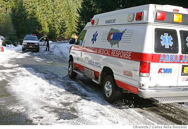 An ambulance joins the rescue group as a precaution on Bear Camp Road outside of Merlin, Oregon, on Tuesday, December 5, 2006. Local and state authorities and search and rescue personnel continued their search for James Kim, the San Francisco man whose family was rescued after they were lost in the mountains outside of Merlin, Or., on Tuesday, December 5, 2006. Kim set out on foot to try to find help, but has not been located although his family was rescued Monday at the family car.  Photo by Carlos Avila Gonzalez/The San Francisco Chronicle  Photo taken on 12/5/06, in Merlin, Or, USA.  **All names cq (source) Photo: Carlos Avila Gonzalez