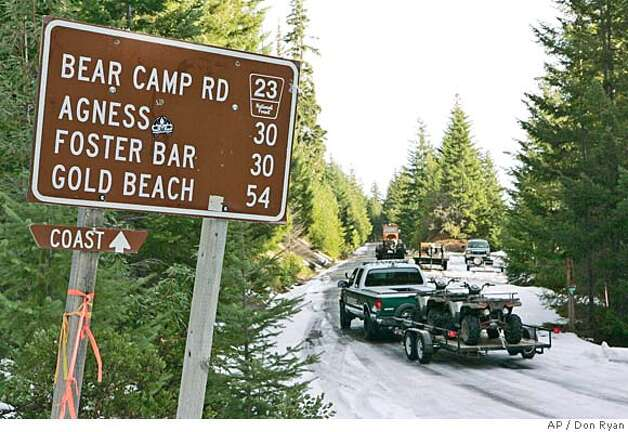 Search crews with all terrain vehicles head down Bear Camp Road in the Siskyou National Forest near Galice, Ore., Tuesday, Dec. 5, 2006, near where the Kim family became stranded in snow. Kati Kim and her two children were found in good health Monday by a helicopter, but James Kim, who tried to hike out, is still missing as of Tuesday morning.(AP Photo/Don Ryan) Photo: Don Ryan