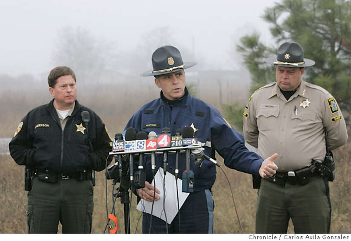Oregon State Police Lt. Greg Hastings details some of the intended plans for search and rescue as the hunt for James Kim continues on Wednesday, December 6, 2006. To his right, is Jackson County Sheriff, Mike Winters, and to the left is Josephine County Undersheriff, Brian Anderson. Local and state authorities and search and rescue personnel continued their search for James Kim on Wednesday, December 6, 2006. The San Francisco man whose family was rescued Monday after they were lost in the mountains outside of Merlin, Or., set out on foot to try to find help, but has not been located. Photo by Carlos Avila Gonzalez/The San Francisco Chronicle Photo taken on 12/6/06, in Merlin, Or, USA. **All names cq (source)