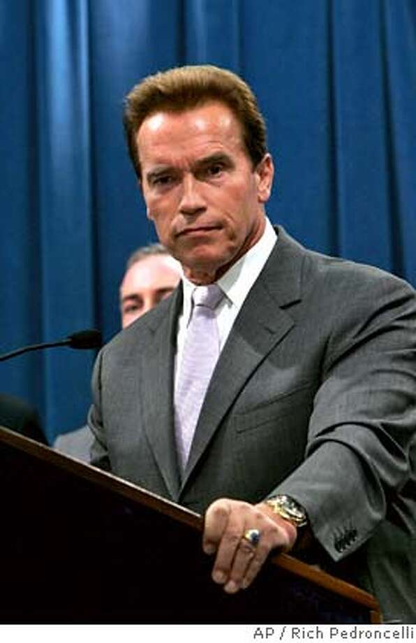 California Gov. Arnold Schwarzenegger, listens to a questions concerning a proposed redistricting plan he supports, during a Capitol news conference in Sacramento, Calif., Tuesday, Dec. 5, 2006. (AP Photo/Rich Pedroncelli) Photo: RICH PEDRONCELLI