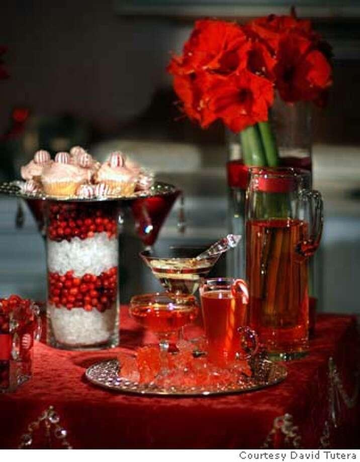 "Red captures the mood of the holidays: closeup of table display from ""The Party Planner'' by David Tutera. Credit: Courtesy David Tutera Photo: Courtesy David Tutera"