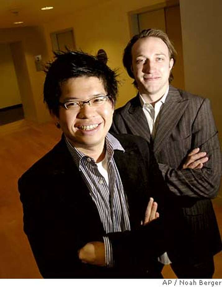 YouTube co-founders Steven Chen, left, and Chad Hurley pose at their San Bruno, Calif., headquarters on Friday, Nov. 10, 2006. Google bought YouTube with 3.66 million shares of its prized stock, including a convertible warrant. When Google closed the takeover late Monday, the shares were worth $1.76 billion, about $100 million above the targeted purchase price of $1.65 billion announced last month. (AP Photo/Noah Berger) Photo: NOAH BERGER