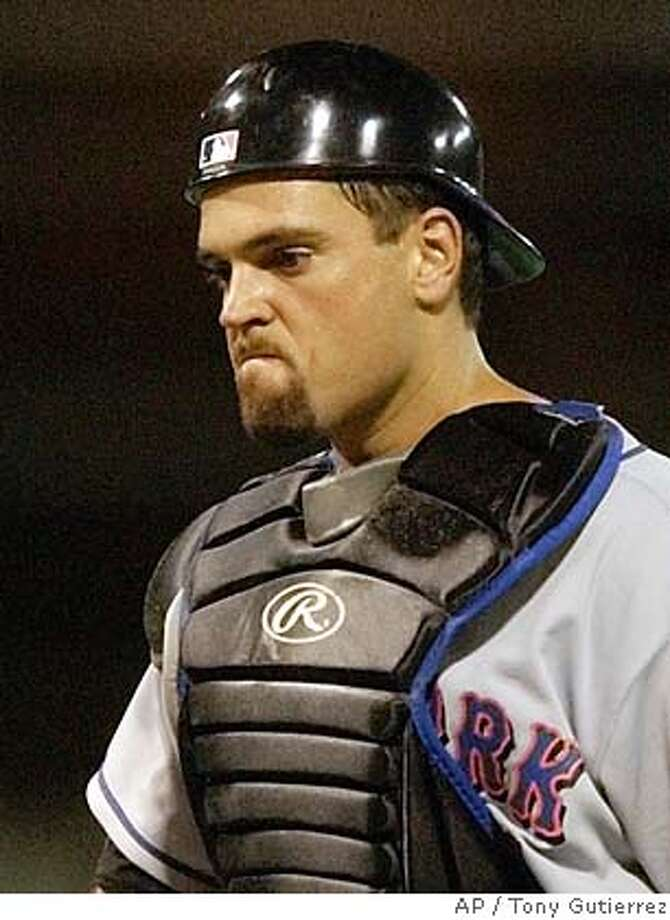 ** FILE ** New York Mets catcher Mike Piazza walks back towards home plate after pitcher Mike Stanton left the game in the bottom of the eighth inning with bases loaded, in this April 14, 2003 photo, at Hiram Bithorn Stadium in San Juan, Puerto Rico. Now that the Mets have finally talked to Piazza about learning to play first base, the All-Star catcher has to learn how. ``I think the general misconception is that I'll take a few groundballs and be a first baseman,'' Piazza said Thursday. ``This is not an easy position to play. It's been years since I played first base. The last thing I want is to be a liability to this team.' (AP Photo/Tony Gutierrez) Ran on: 07-23-2004  Mike Piazza likely is the best all-around hitting catcher ever. Ran on: 01-30-2006 Ran on: 01-30-2006 CAT Photo: TONY GUTIERREZ