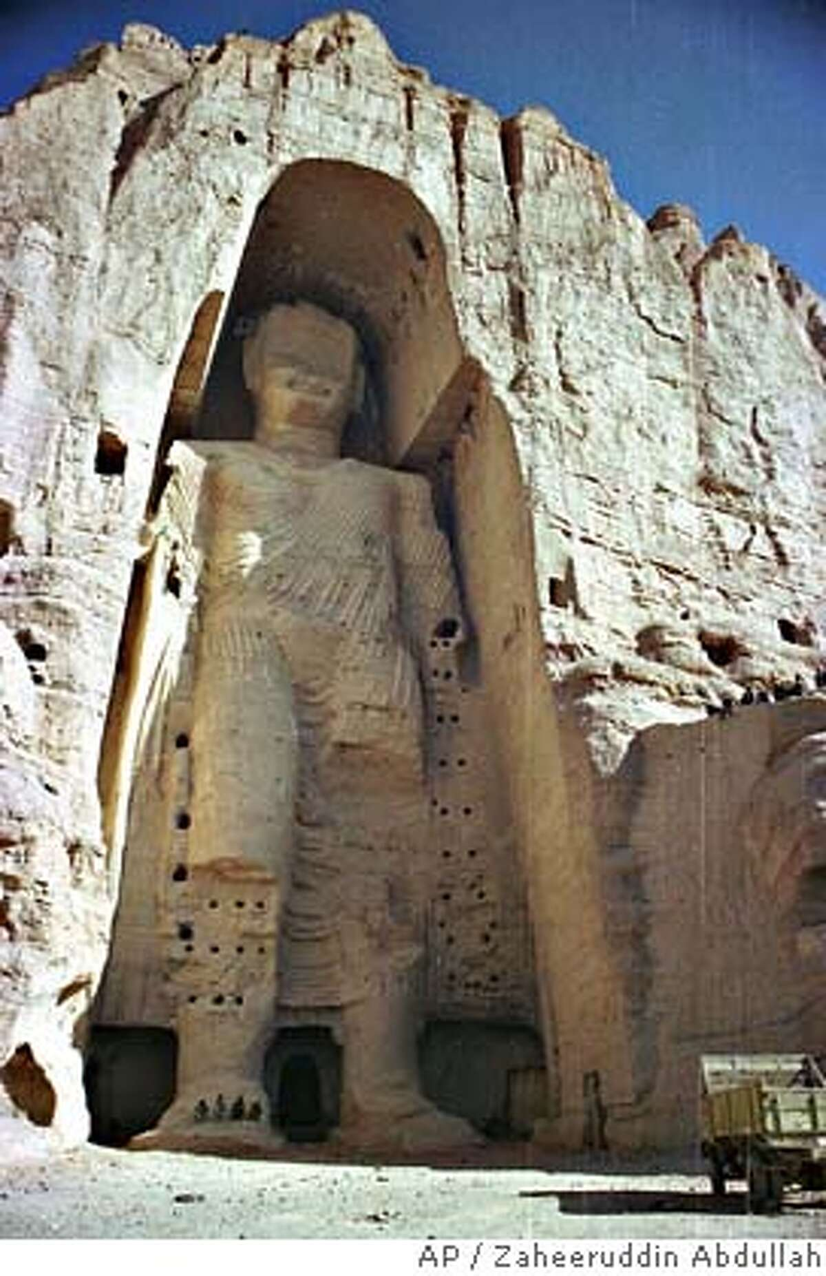 **FILE** The 53-meter (175-foot) tall, 2000-year-old Buddha statue located in Bamyan, about 150 kilometers (90 miles) west of the Afghan capital of Kabul, is shown in this undated file photo. In March 2001, Taliban militants disregarded worldwide protests and used dynamite and artillery to blow up the original fifth-century statues, including this statue, famed for their size and location along the ancient Silk Road linking Europe and Central Asia. The fundamentalist group considered the Buddhas idolatrous and anti-Muslim. (AP Photo/Zaheeruddin Abdullah, FILE) Ran on: 08-14-2005 Laser images of Buddha are set to be created by artist Hiro Yamagata, who will then project them across Bamiyan Valley, Afghanistan. UNDATED FILE PHOTO