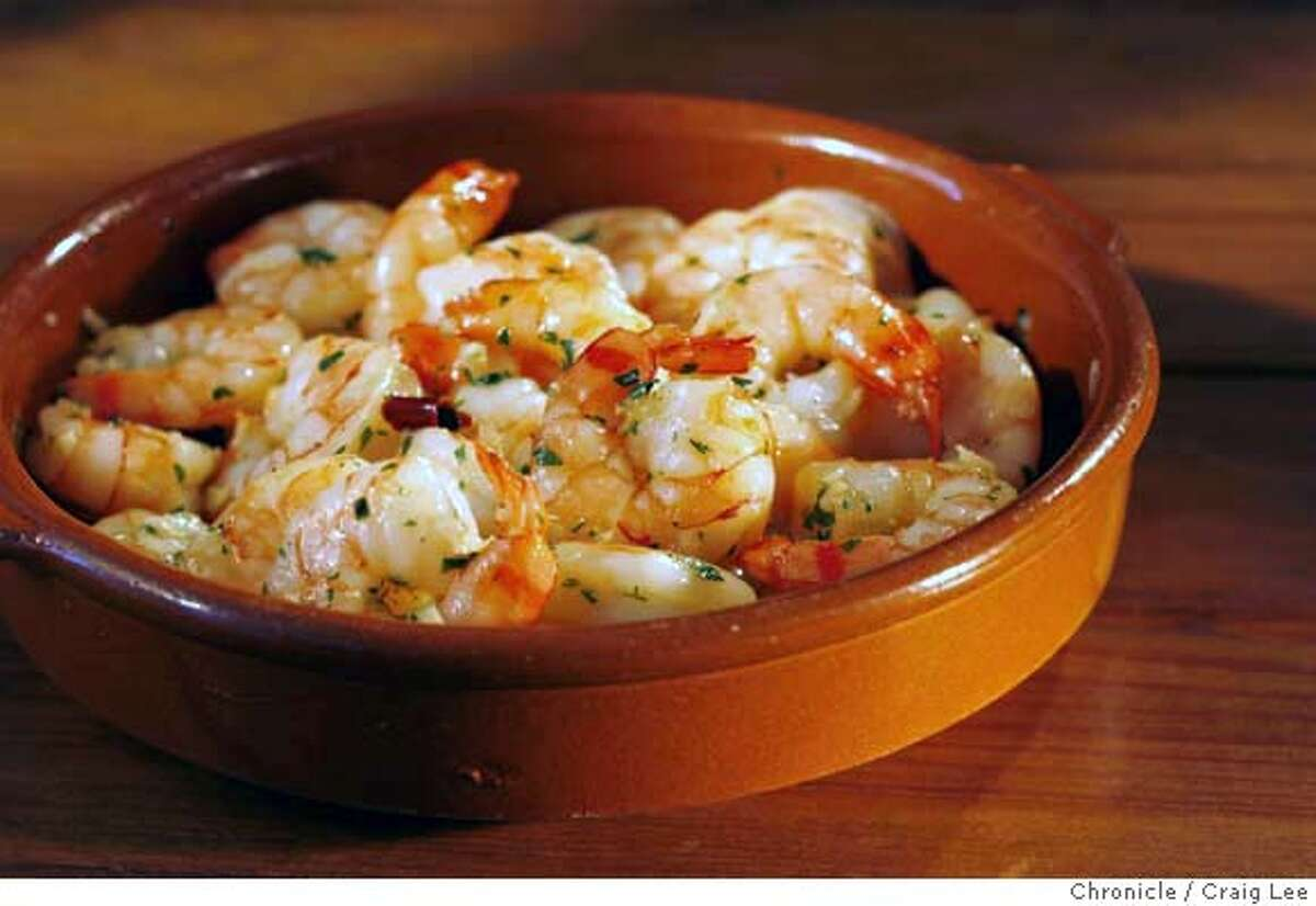 HOLIDAYENTERTAIN06_391_cl.JPG Photo on three 90-minute dinner party menus for holiday entertaining story by Janet Fletcher. Photo of garlic shrimp with sherry. Event on 11/30/06 in San Francisco. MANDATORY CREDIT FOR PHOTOG AND SF CHRONICLE/ -MAGS OUT