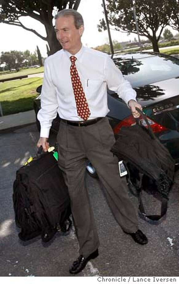 KNIGHT_ANNAUNCE_0055.jpg_  George Riggs Publisher of the San Jose Mercury News picks up Dean Singleton, CEO of MediaNews Group bags from the trunk of Tony Ridder after the announcement that the newspaper was sold to leaves the offices of the San Jose Mercury News after meeting with employees to announce the sale of the newspaper from Knight Ridder to MediaNews Group. Ran on: 12-05-2006  Publisher George Riggs said the agreement offers flexibility.  Ran on: 12-05-2006  Publisher George Riggs said the agreement offers flexibility. Photo: Lance Iversen