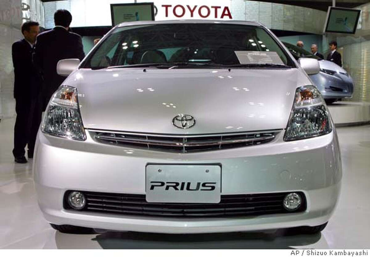 ** FILE ** Toyota Prius hybrid compact car is exhibited at the Tokyo Motor Show in Makuhari, east of Tokyo, in a file photo from Oct. 19, 2005. Toyota Motor Corp. is recalling 418,570 vehicles globally, including some Echo and Prius models sold in the U.S., over a faulty engine part. (AP Photo/Shizuo Kambayashi, File) Ran on: 08-01-2006 Buyers are eschewing mid-sized SUVs while turning to models with better fuel economy such as Toyotas Prius hybrid. OCT. 19, 2005 FILE PHOTO