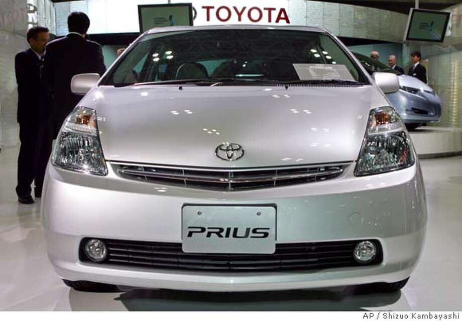** FILE ** Toyota Prius hybrid compact car is exhibited at the Tokyo Motor Show in Makuhari, east of Tokyo, in a file photo from Oct. 19, 2005. Toyota Motor Corp. is recalling 418,570 vehicles globally, including some Echo and Prius models sold in the U.S., over a faulty engine part. (AP Photo/Shizuo Kambayashi, File)  Ran on: 08-01-2006  Buyers are eschewing mid-sized SUVs while turning to models with better fuel economy such as Toyota's Prius hybrid. OCT. 19, 2005 FILE PHOTO Photo: SHIZUO KAMBAYASHI