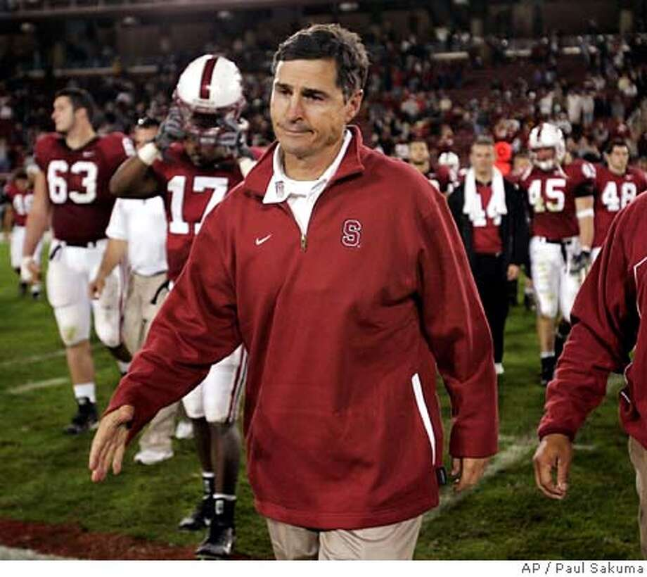 ** FILE ** Stanford head coach Walt Harris walks off the field after Stanford lost to Southern California, 42-0, in their NCAA football game, Saturday, Nov. 4, 2006, in Stanford, Calif. Walt Harris was fired Monday Dec. 4, 2006 as Stanford's football coach, two days after finishing the worst season in more than four decades at the school. (AP Photo/Paul Sakuma) Photo: PAUL SAKUMA