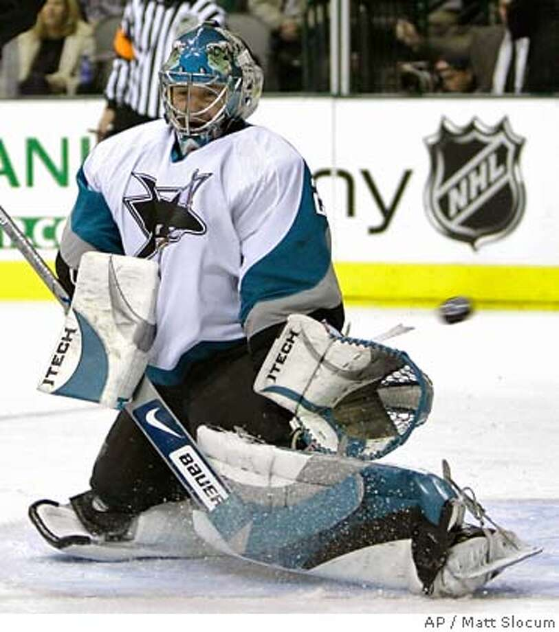San Jose Sharks goalie Evgeni Nabokov, of Kazakhstan, can't block a shot by Dallas Stars center Mike Modano in the first period of an NHL hockey game, Monday, Dec. 4, 2006, in Dallas. (AP Photo/Matt Slocum) Photo: MATT SLOCUM