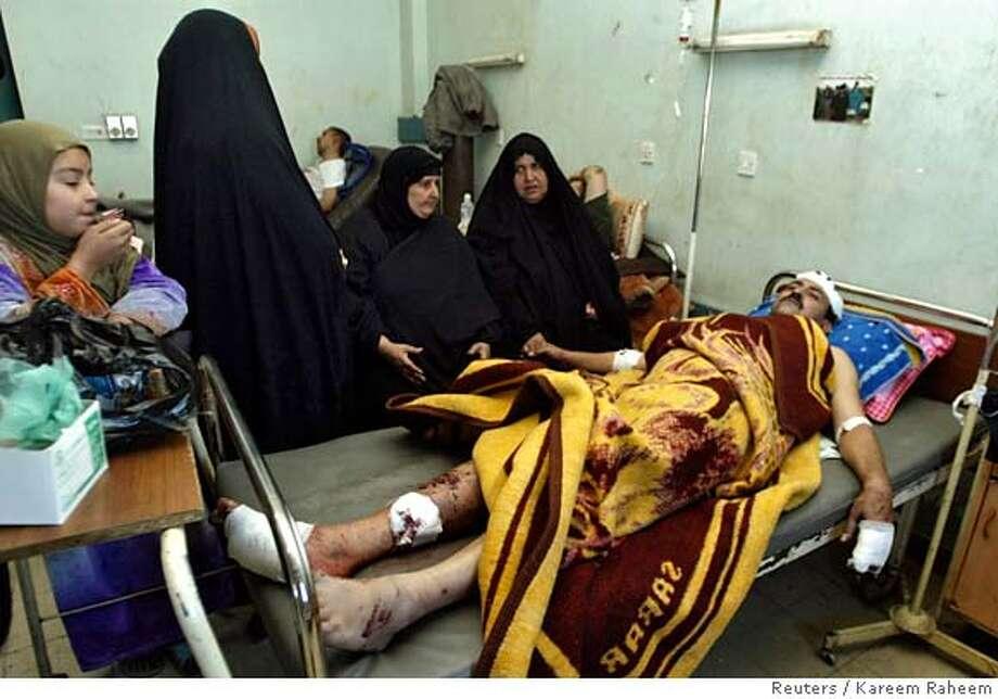 A victim of Saturday's car bomb attacks rests at a hospital in Baghdad's Sadr city December 3, 2006. REUTERS/Kareem Raheem (IRAQ) 0 Photo: KAREEM RAHEEM