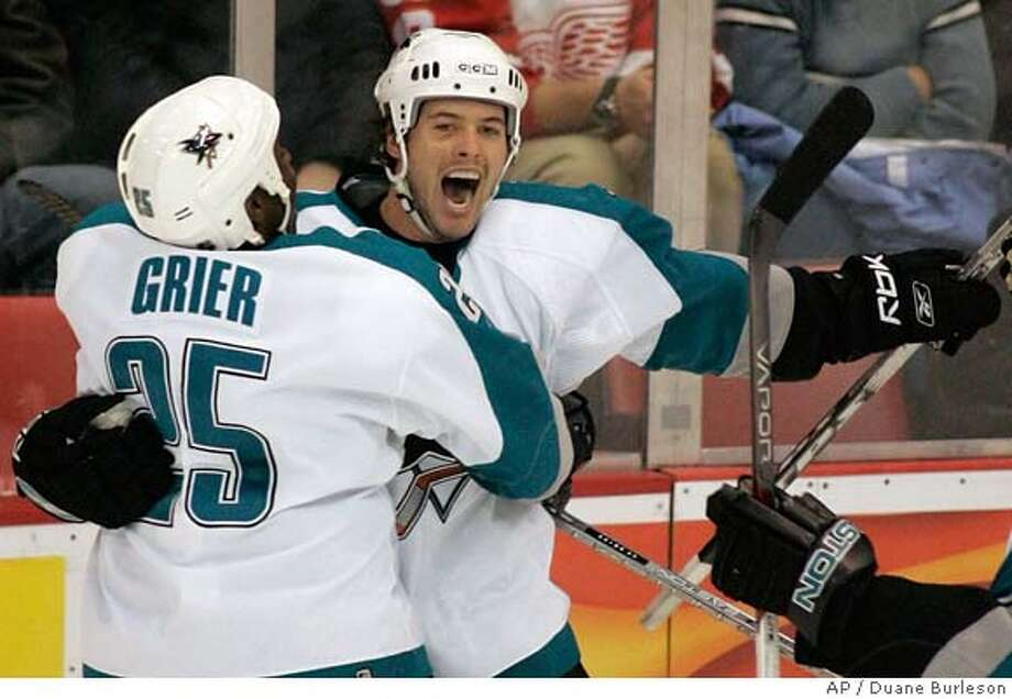 San Jose Sharks' Mark Bell, right, celebrates with Mike Grier after scoring the game-tying goal in the third period of an NHL hockey game against the Detroit Red Wings on Saturday, Dec. 2, 2006, in Detroit. The Sharks beat the Red Wings 3-2 when Joe Pavelski scored with six seconds remaining. (AP Photo/Duane Burleson) EFE OUT Photo: DUANE BURLESON
