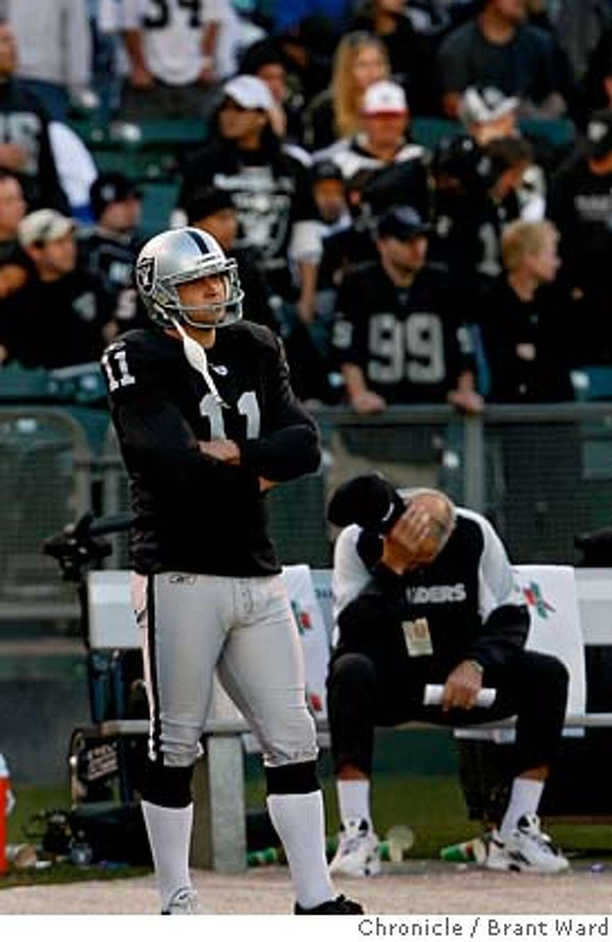 Sebastian Janikowski stood dejected on the sidelines as time ran out on his Raiders. Janikowski had three missed field goals. The Oakland Raiders action vs. Houston Texans at McAfee Coliseum Sunday December 3. The Raiders lost 23-14. {Brant Ward/San Francisco Chronicle}12/3/06