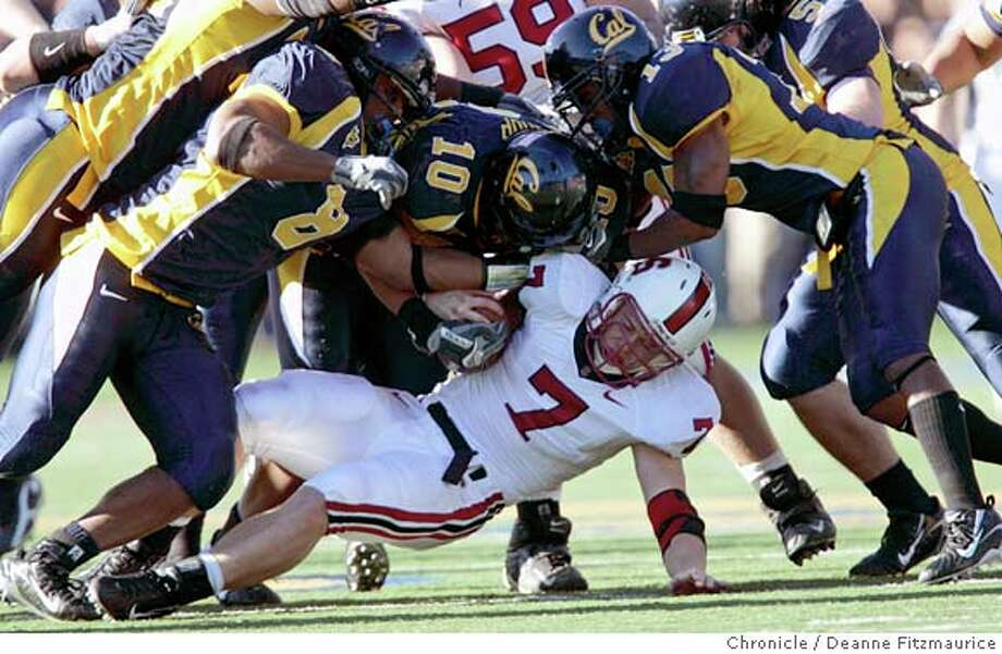 "biggame_0749_df.jpg  Toby Gerhart is tackled by a pack of Bears. The California Golden Bears play the Stanford Cardinal at Memorial Stadium in the annual ""Big Game"". Photographed in Berkeley on 12/2/06. (Deanne Fitzmaurice/ The Chronicle) Ran on: 12-03-2006  Stanford running back Toby Gerhart has nowhere to go but down against a Cal defense led by Mickey Pimentel (8), Desmond Bishop (10) and Daymeion Hughes (13).  Ran on: 12-03-2006  Stanford running back Toby Gerhart has nowhere to go but down against a Cal defense led by Mickey Pimentel (8), Desmond Bishop (10) and Daymeion Hughes (13).  Ran on: 12-03-2006  Stanford running back Toby Gerhart has nowhere to go but down against a Cal defense led by Mickey Pimentel (8), Desmond Bishop (10) and Daymeion Hughes (13). Photo: Deanne Fitzmaurice / San Francisco Chronicle"