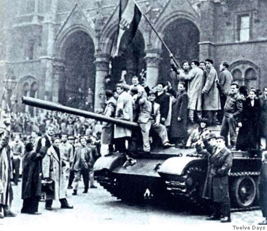 "Hungarians celebrate in front of the Hungarian parliament in Budapest on Oct. 28, 1956. But on Nov. 4, the Soviets crushed the revolution. Photo from ""Twelve Days"""