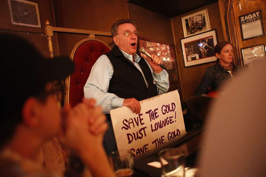 On day the the owners of the Gold Dust Lounge were supposed to leave, Lee Housekeeper, spokesperson for the Bovis family, announces to a full house, that the Gold Dust Lounge is not going anywhere for now on March 10, 2012 in San Francisco, Calif.   Last December the owners of the Gold Dust lounge, at 247 Powell Street, received a notice from their landlord, the Handlery Hotel, to be out in 90 days to make way for new retail. After nearly 47 years running the bar, the Bovis brothers are not ready to go without a fight. Photo: Mike Kepka