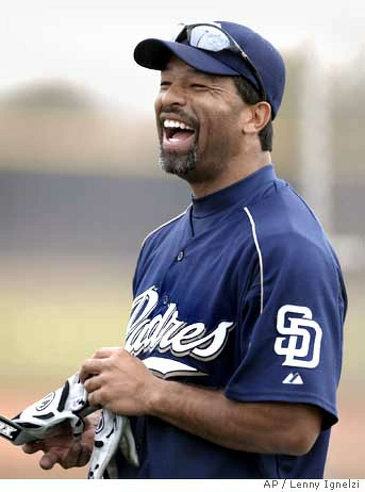 San Diego Padres centerfielder Dave Roberts smiles during workouts at the teams' spring training camp Friday, March 18, 2005, in Peoria, Ariz. The Padres expect Roberts to cover the spacious PETCO Park outfield and to be the leadoff hitter they have lacked. (AP Photo/Lenny Ignelzi) Ran on: 03-27-2005 The Padres expect Dave Roberts to cover center field in spacious PETCO Park and to be the leadoff hitter they have lacked. Ran on: 11-25-2006 Rich Aurilia Ran on: 11-25-2006 Rich Aurilia