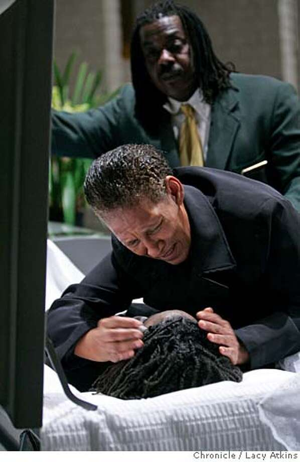 Anthony London comforts Mary Lee Dunbar as she views her grandson Wayne Gordon Jr. during his wake, Tuesday November 14, 2006, in Oakland, Ca. A look at Oaklands high homicide rate through the eyes of Anthony London, a mortician for Whitter and Williams. (Lacy Atkins/The Chronicle) Photo: Lacy Atkins