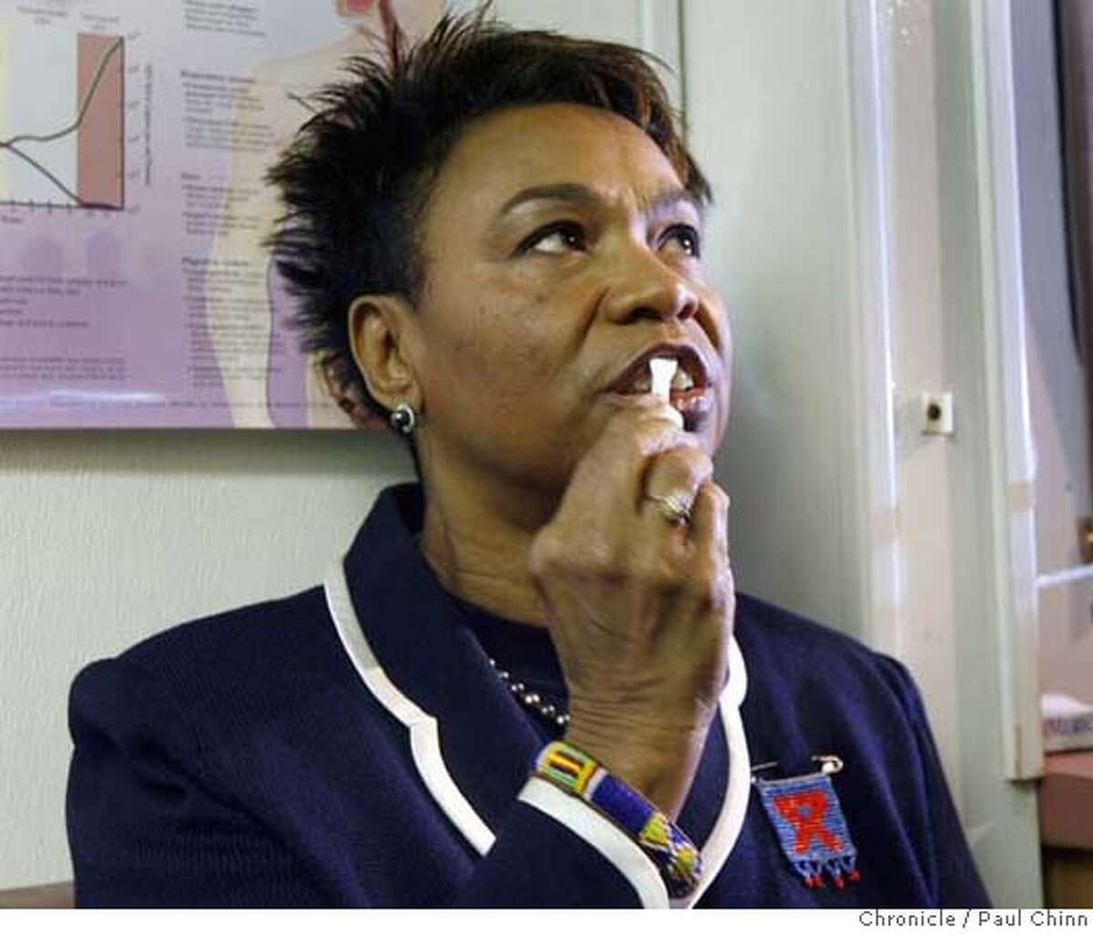 Congresswoman Barbara Lee rubs a swab across her gums as she's tested for HIV to observe World AIDS Day and encourage testing among the African-American and other minority communities in Oakland, Calif. on Friday, Dec. 1, 2006. African-Americans account for nearly 50 percent of all AIDS/HIV cases in the country, according to a release from the congresswoman's office. Oakland mayor-elect Ron Dellums was scheduled to attend the event but was a no-show. PAUL CHINN/The Chronicle **Barbara Lee, Ron Dellums