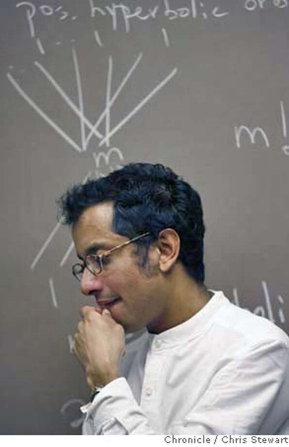STANFORDMATH_0070_cs.jpg  Ravi Vakil, an Associate Professor in the Department of Mathematics at Stanford University ponders a students solution to a math problem. Vakil who, according to his website, each fall coordinates the William Lowell Putnam competition at Stanford, and in conjunction with that runs a weekly seminar for talented undergraduates, as well as a problem-solving Masterclass for experts. This year the Sixty-Seventh Annual William Lowell Putnam Mathematical Competition will be held on Saturday, December 2, 2006 and is administered by The Mathematical Association of America.  Chris Stewart / The Chronicle Ravi Vakil, Stanford, William Lowell Putnam Mathematical Competition Ran on: 12-02-2006  Associate Professor Ravi Vakil ponders a student's solution to a math problem. Photo: Chris Stewart