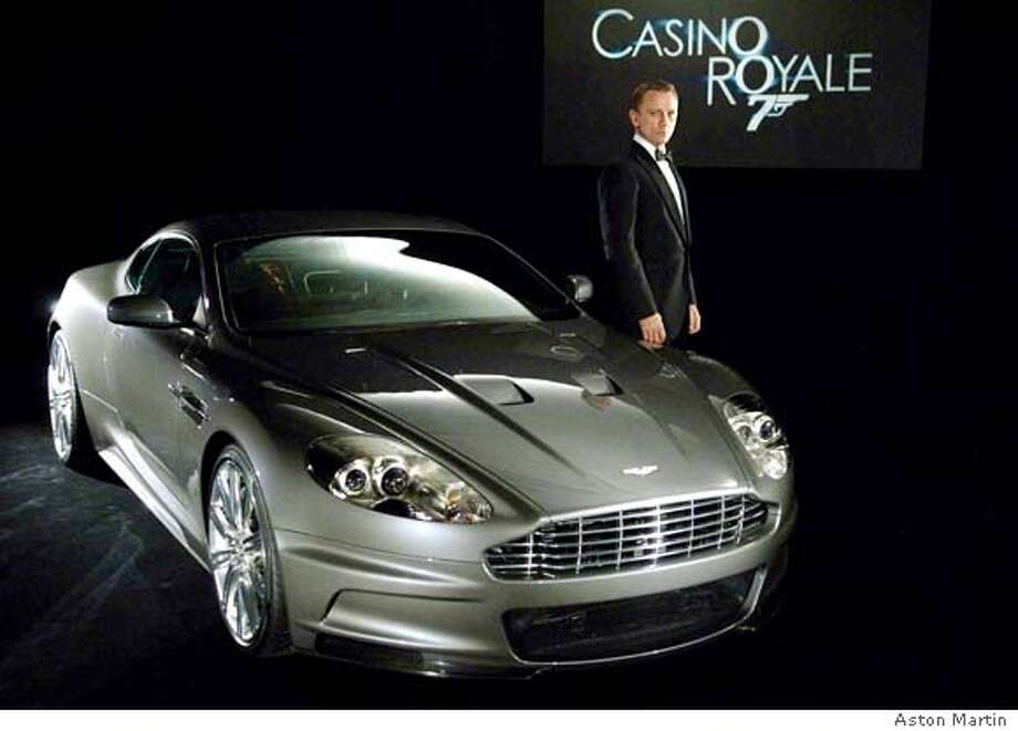(NYT14) UNDATED -- November 17, 2006 -- AUTOS-ASTON-MARTIN -- While Ford entertains offers for Aston Martin, a new James Bond, played by Daniel Craig, pictured, is driving the new DBS in the latest 007 film. (Aston Martin/The New York Times) Ran on: 12-02-2006  The Aston Martin DBS, the spy version of the venerable vehicle in the 007 films, is shown here with the latest James Bond, actor Daniel Craig.  Ran on: 12-02-2006 Ran on: 12-02-2006 Ran on: 12-02-2006  The Aston Martin DBS, the spy version of the venerable vehicle in the 007 films, is shown here with the latest James Bond, actor Daniel Craig. Photo: Aston Martin