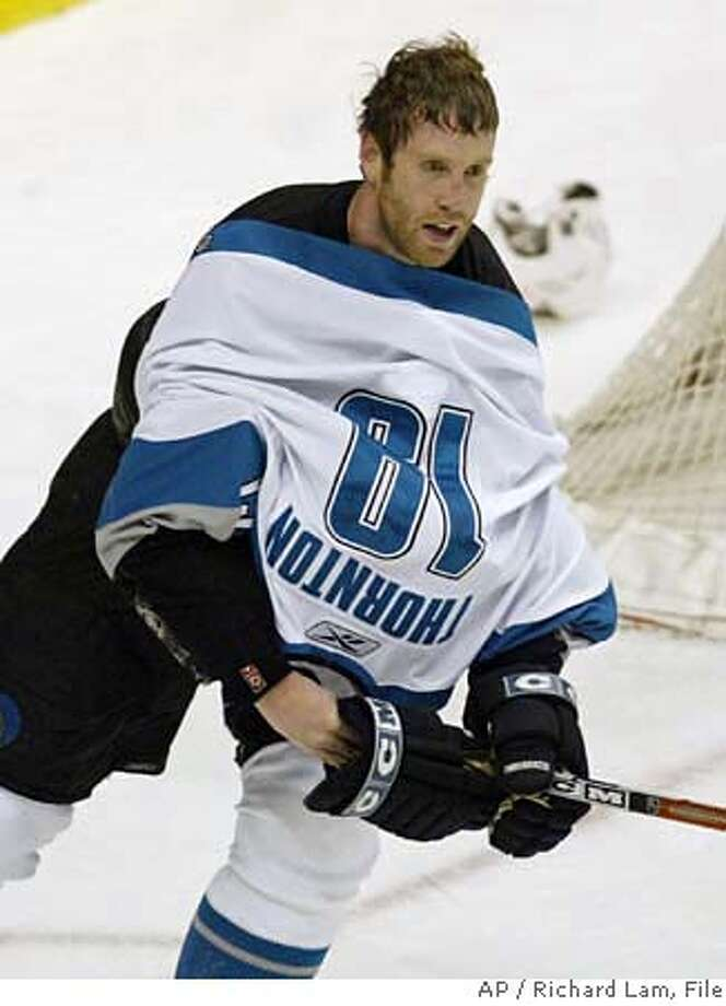 San Jose Sharks' Joe Thornton continues to play with his jersey pulled over his head during the third period of NHL hockey action against the Vancouver Canucks in Vancouver, Wednesday, April 12, 2006. Thornton's jersey was pulled over his head by a Canucks player. The Sharks defeated the Canucks 5-4 in overtime. (AP PHOTO/CP, Richard Lam)Ran on: 04-16-2006  The Sharks' acquisition of Joe Thornton may go down as one of the best deals in Bay Area history.Ran on: 04-16-2006  The Sharks' acquisition of Joe Thornton may go down as one of the best deals in Bay Area history.Ran on: 04-16-2006  The Sharks' acquisition of Joe Thornton may go down as one of the best deals in Bay Area history. Photo: RICHARD LAM