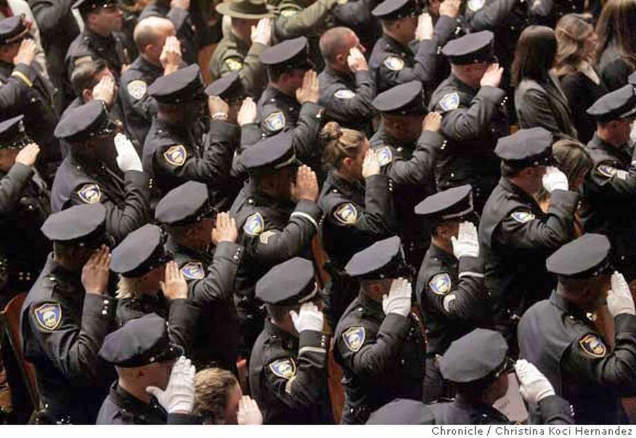 At the RICHMOND MEMORIAL AUDITORIUM, Richmond police salute their slain colleague at the memorial service for Richmond police detective, Kaliah Harper, who was killed Nov.24, while off duty in Fairfield.(CHRSTINA KOCI HERNANDEZ/CHRONICLE) Photo: CHRISTINA KOCI HERNANEZ/CHRONICL