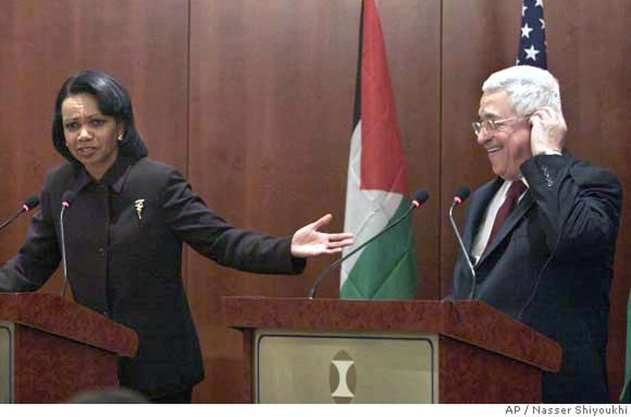 "United States Secretary of State Condoleezza Rice, left, gestures as she speaks as Palestinian Authority President Mahmoud Abbas looks on at a press conference in the West Bank town of Jericho, Thursday, Nov. 30, 2006. Secretary of State Condoleezza Rice called on Israelis and Palestinians Thursday to step up efforts to achieve peace, saying neither side should take actions that would prejudge a final accord. ""Hopefully we can take this moment to accelerate our efforts and intensify our efforts toward the two-state solution that we all desire,"" Rice said at a news conference with Palestinian President Mahmoud Abbas in the West Bank town of Jericho. (AP Photo/Nasser Shiyoukhi) Photo: NASSER SHIYOUKHI"