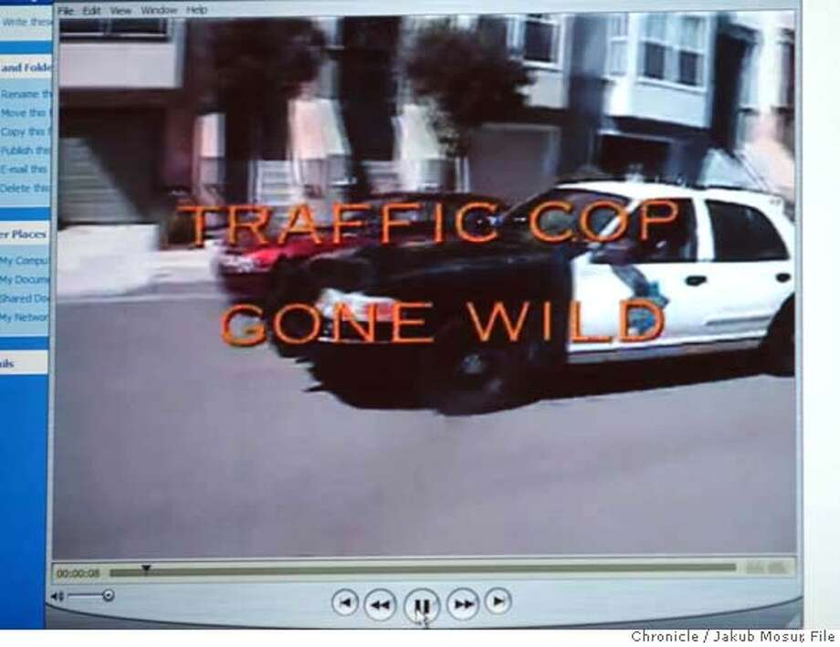 A police car is seen in this still frame from a video made available by authorities during a press conference in San Francisco, Wednesday, Dec. 7, 2005. One police officer was suspended and more than a dozen others faced discipline after making videos parodying life on the force that used racist, sexist and homophobic stereotypes, officials announced. About 20 officers participated in creating or performing in the videos that included inappropriate and outrageous content, according to Mayor Gavin Newsom and Police Chief Heather Fong. (AP Photo/The Chronicle, Jakub Mosur)** MANDATORY CREDIT MAGS OUT ** Ran on: 12-15-2005  The police video &quo;scandal&quo; was touched off by a batch of sophomoric pranks that come off like video versions of a note passed in the back of class. STILL PHOTO MADE FROM VIDEO MANDATORY CREDIT FOR PHOTOG AND SF CHRONICLE/ -MAGS OUT Photo: JAKUB MOSUR