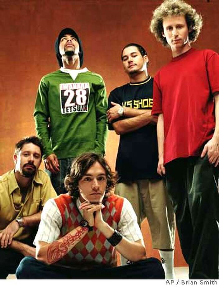 """ADVANCE FOR WEEKEND EDITIONS, NOV. 29-DEC 2-The rock band Incubus, which started in a Calabasas, Calif., garage more than a decade ago, just released its fifth album, """"Morning View,"""" which debuted No. 2 on the charts. Members of Incubus, crouching from left, are Dirk Lance and Brandon Boyd; standing, Chris Kilmore, Jose Pasillas II and Mike Einziger, shown in this July 2001 promotional photo. (AP Photo/ Brian Smith) HFR 11-29-01. ADVANCE FOR WEEKEND EDITIONS, NOV. 29-DEC. 2. Photo: BRIAN SMITH"""