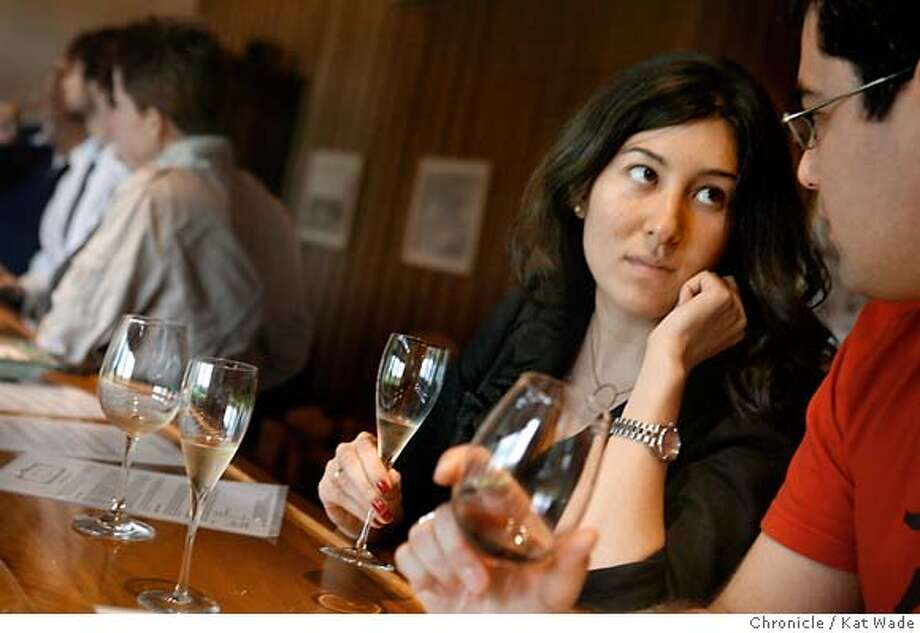 SPARKLERS01_173_KW_.jpg  (L to R) Marrissa Kim from New York and Sean Masterson from Boston taste sparkling wines in the tasting room at French owned Roederer Estate winery where they create sparkling wines in the coastal region of Philo, California on Tuesday November 21, 2006. Kat Wade/The Chronicle Ran on: 12-01-2006  Marissa Kim of New York and Sean Masterson of Boston taste sparkling wines at Roederer Estate Winery in Philo. Photo: Kat Wade