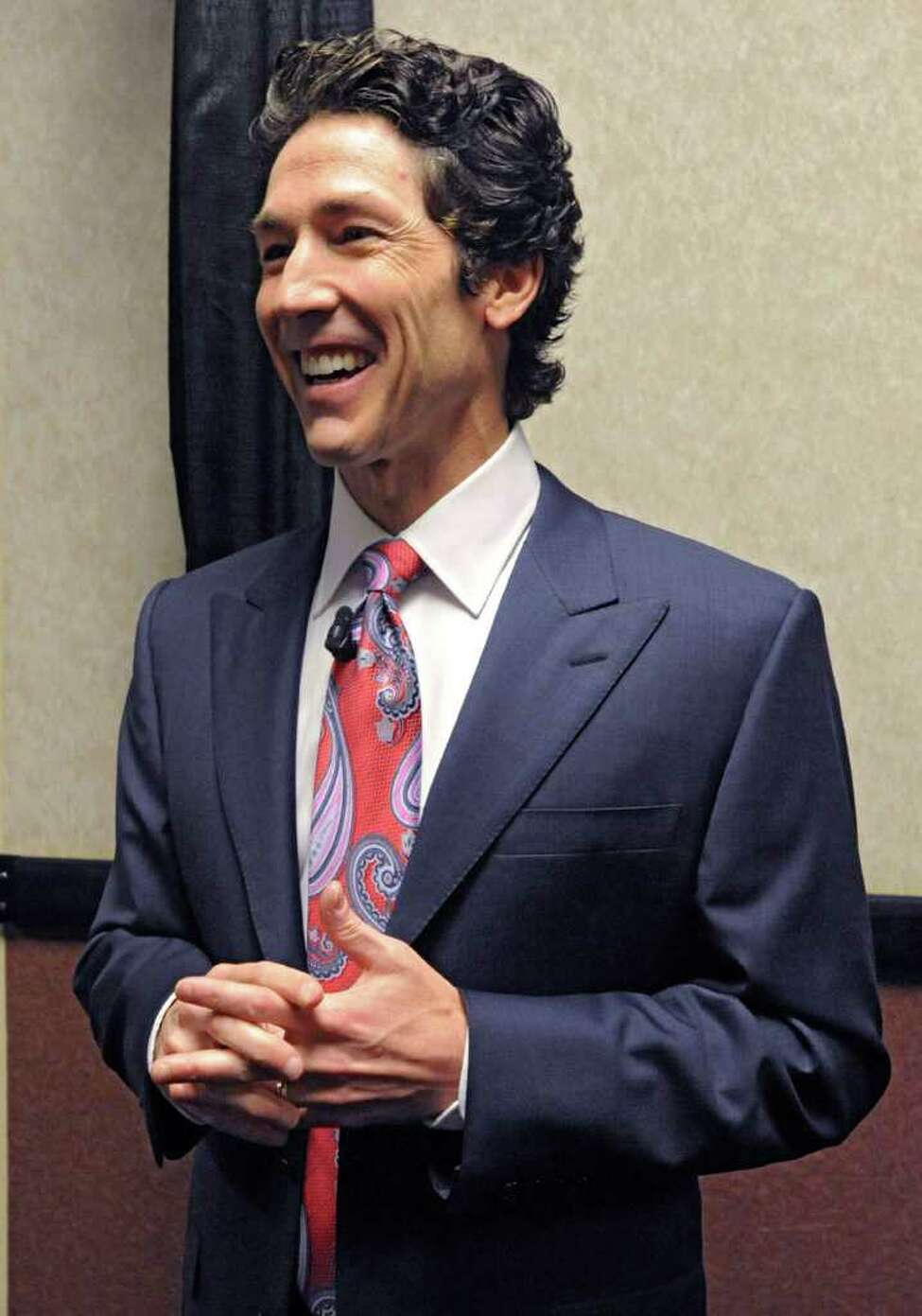 Joel Osteen talks to a reporter before he preaches at theTimes Union Center March 16, 2012 in Albany, N.Y. Osteen is a televangelist and the senior pastor of Lakewood Church in Houston, Texas. (Lori Van Buren / Times Union)