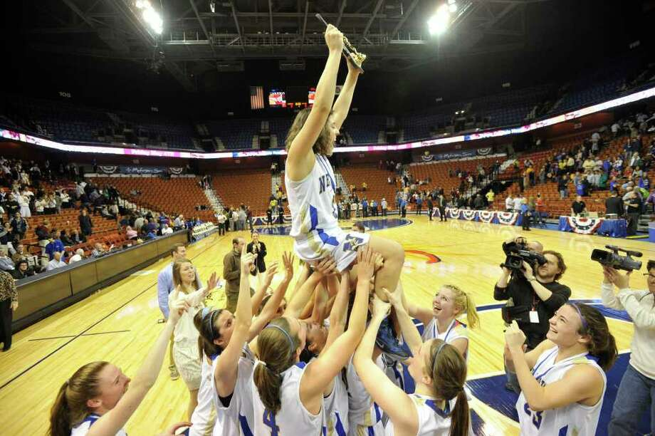 The Newtown Nighthawks lift their teammate Riley Wurtz into the air in celebration after their 44-42 Class LL championship win over the Mercy Tigers at Mohegan Sun Arena in Uncasville on Friday, March 16, 2012. Photo: Jason Rearick / The News-Times