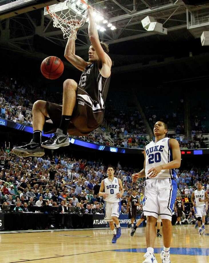 Lehigh's Gabe Knutson gets a dunk ahead of the Duke defense. Photo: AP